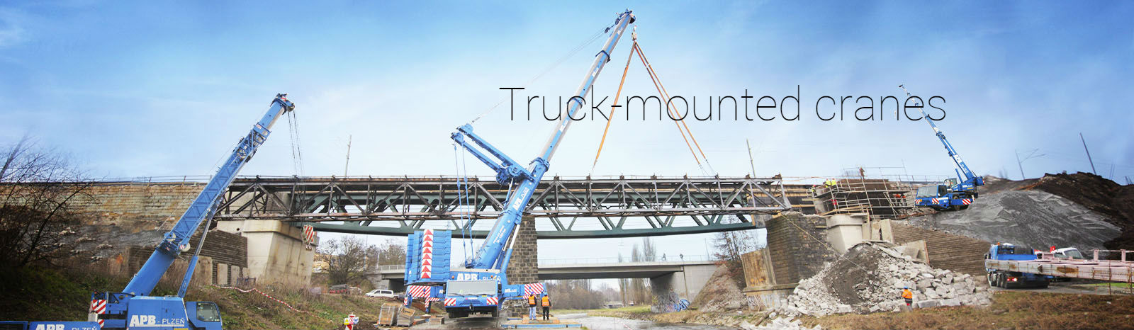 Truck-mounted cranes